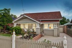 This charming Californian bungalow, offered for only the second time since the has provided exceptional enjoyment for its present owners for over Exterior Color Schemes, Exterior Paint Colors For House, House Color Schemes, Exterior Design, Bungalow Exterior, Bungalow Renovation, Craftsman Exterior, Red Roof House, Facade House