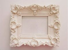 have always wanted to paint an old frame white (after some real simple article). re-inspired.