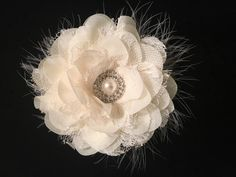 A personal favorite from my Etsy shop https://www.etsy.com/listing/266863956/ivory-chiffon-flower-marabou-hair