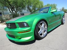 Highly customized Mustang built for the Las Vegas SEMA show by Street Scene Equipment. Featuring a wild House of Kolors Candy Apple Pearl Green paint job don...