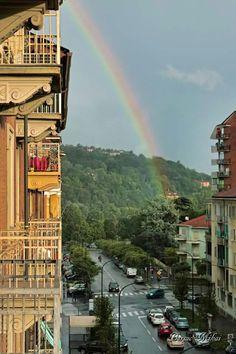 Collina torinese con arcobaleno