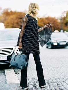 Pair a bell-sleeve tunic with flare jeans.