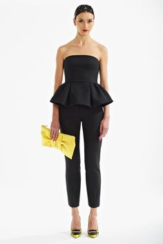 Black peplum with black pants, yellow clutch and shoes