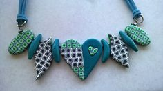 Polymer clay heart necklace in green, teal, black and white. Blue suede cord.