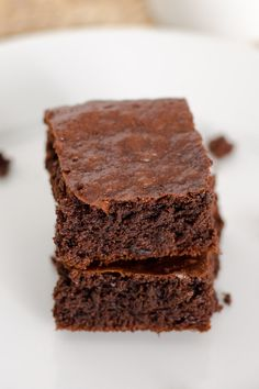 A quick and easy paleo brownie recipe to satisfy your chocolate craving. Make in a food processor — no bowls needed — and they are in the oven in 5 minutes.
