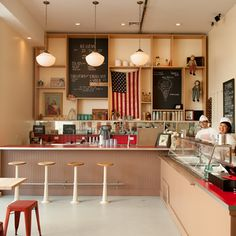 The store has a nostalgic, kid-friendly feel which is as American as pumpkin pie – probably coming soon as an ice cream flavour. Toys and dolls perch on the shelves next to the Stars and Stripes, and the uniforms have an infectious retro charm...