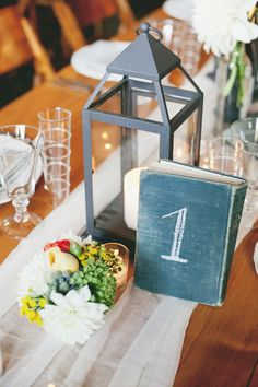 Books as table numbers. Photography: onelove photography - onelove-photo.com  Read More: http://www.stylemepretty.com/2013/12/20/rustic-olympias-valley-wedding/
