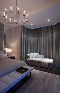interior design: modern luxe hotel suite style master bedroom with grey taupe colour palette. upholstered headboard, bench seat, carpet, curtains (it)