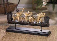 Picture of Elephant Family Carved Decor. This bejeweled family of elephants brings good luck and great design to your living space!