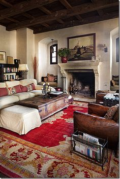 "(BrandonRugs.com) Are you one to fret endlessly about covering a rug border or medallion, or whether or not everything is ""lined up properly""? This is an example of derring-do. Try it. If it looks great, who will have the courage to question your boldness? (""Beautiful living room, ticks all the boxes ... beamed ceiling, old leather chairs, fireplace with seating nooks *sigh*)"