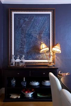 moody blue palette, dark furniture, large-scale art, unusual lamps