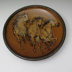 Denise and Paul Morris - Plate with three horses slip trailed pottery