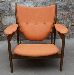 A Mid Century Modern armchair, after Hans Wegner. The chair is walnut with a deep finish and features an orange twill upholstery. Mid Century Modern Armchair, Mid Century Chair, Mid Century Modern Furniture, Everything But The House, Online Estate Sales, Hans Wegner, Sofa Chair, Seat Cushions, Mid-century Modern