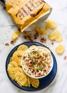 Loaded Baked Potato Dip recipe - perfect for football parties and tailgating. Because everyone loves bacon and cheese!