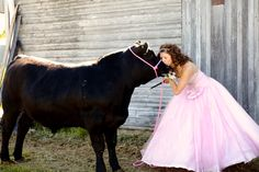 Trash your prom dress and take a pic with your steer..um doing this!