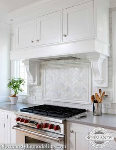 Tile backsplash ideas can vary greatly, but this one works so well in this white and gray kitchen. (Cultivate.com)