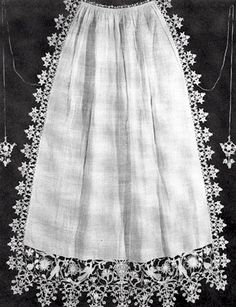 """Apron. White linen, border of punto in aria. Ties of fine cord with ends of punto in aria. Italy, late 16th or early 17th century.""    Lace and Lace Making, Marian Powys, Dover Publications, 2002"