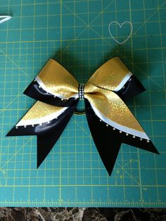Double Wave Gold, White and Black Cheer Bow with Rhinestones By Elite Cheer Bows