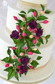 Fuchsias in bloom wedding cake.Gum paste Fuchsias and buds.