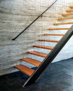 Whitewater kayaker brings work home - stunningly modern, riverside retreat - Two-story concrete wall lines the open-riser stairway and absorbs heat in th ewinter and retains cool night air in the summer Stone Stairs, Concrete Stairs, Metal Stair Railing, Railings, Stairs In Kitchen, Basement Steps, Open Stairs, Stair Lighting, Painted Stairs