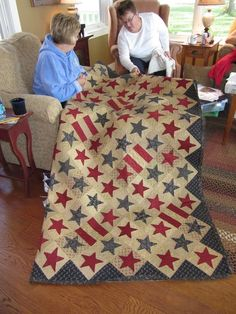 awesome colors...doing the stars would drive me to drink, though.....but I do love the quilt....
