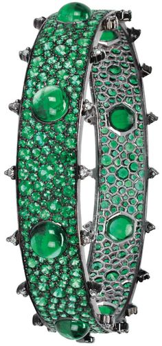 Gemfields' bangle by Nam Cho is made with 23ct of Zambian emeralds in varying sizes of cabochon cuts for a dramatic and very tactile effect.     Via The Jewellery Editor.