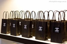 CoCo Chanel Black Tote Bags with Chanel Logo. Great for Chanel Themed Parties, Bridal Showers, wedding showers Chanel Party Chanel Decorations Chanel Party Favors Chanel Favors Chanel Tote Bag Chanel Party, Chanel Birthday Party, 30th Party, 30th Birthday Parties, Sweet 16 Birthday, Chanel Wedding, 41st Birthday, Birthday Ideas, Coco Chanel
