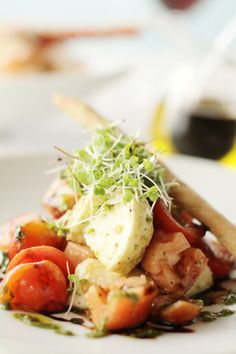 Tomato and mozzarella salad with basil pesto and grissini at Coba restaurant at Viceroy Anguilla.