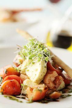 Tomato and mozzarella salad with basil pesto and grissini at Coba restaurant at Viceroy Anguilla.