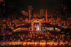 Breathtaking ceremony with 9,000 candles surrounding the bride and groom