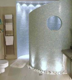 Curved walk in shower - love the lighting detail
