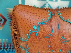 It's all in the details!  Sumptuous saddle tan #leather with turquoise filigree underlay combine with sterling and turquoise conchos and twisted fringe to create a #Western #pillow group that you'll love in any room in your home!  stargazermercantile.com