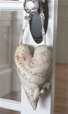 A valentine note in the form of a little heart hung on a loved one's door!  Love this idea!