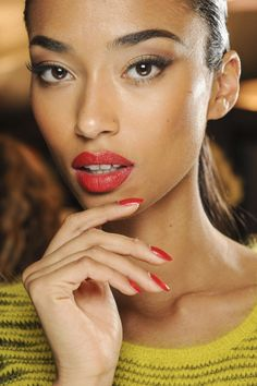 French model Anais Mali puts a modern twist on a classic winged eyeliner and red lip