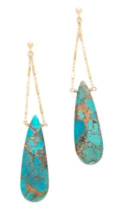 Copper veins shimmer along the turquoise teardrops on these delicate chain earrings from Heather Hawkins. Post closure.14k gold fill.Made in the USA.NOTE: These earrings are made from natural stones. Shading, size, and shape may vary.MEASUREMENTSLength: 3in / 7.5cm