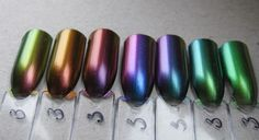 ILNP Multichromes. From left to right: Nostalgia, Abundance, Undenied, Birefringence, Sirene, Reminisce, Mutagen. The picture doesn't do especially Mutagen justice, it's much more duochrome IRL, shifting to purple and burgundy at extreme angles.