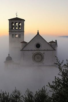 The Basilica of Saint Francis of Assisi, Italy shrouded in early morning mist.