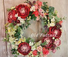 大輪の赤いラナンキュラスのお花がとってもかわいいリースです。ラナンキュラスやバラの花等は工芸粘土でできています。ラズベリーやブルーベリーサンキライの実などたく...|ハンドメイド、手作り、手仕事品の通販・販売・購入ならCreema。