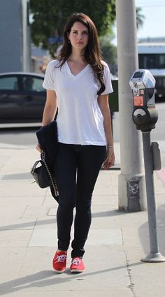 Lana Del Rey flaunts blue denim with a white tee and red Converse