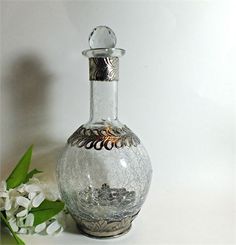 Unusual crackle glass decanter with what appears to be intricate sterling silver…