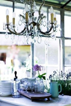 Dining room with flowers & chandelier