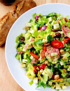 Italian salad. Romaine lettuce, grape tomatoes, chickpeas, artichoke hearts, green and black olives, red onion, roasted red peppers, cucumbers, diced provolone cheese, salami and cooked ditalini pasta. Vinaigrette dressing. (I am leaving out the salami)