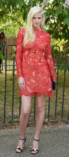 Simply stunning: Lara Stone showed off her long legs in a red dress designed by Christopher Kane at the Serpentine Gallery bash in Kensington Gardens on Thursday, 2 July 2015.