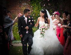 Goan bride & groom confetti shot wedding photography.