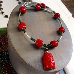 Coral Buddha figure and silver necklace £119.00