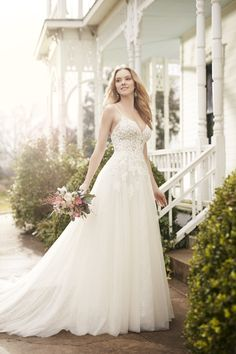 Illusion beaded lace bodice with full A-line tulle skirt.
