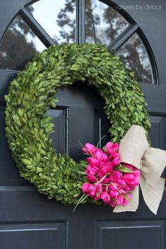 Gorgeous spring wreath with silk tulips and burlap bow - post includes link to purchase!