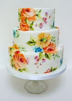 This is a painted cake using the lowers for the wedding, They were nice and bright with orange roses, yellow gerberas and pink and purple sweet pea.