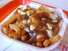 """Poutine (poo-TEEN, or puh-TSIN) is a popular fast food in the French-speaking Canadian province of Québec. The name means """"mess"""" in French, and a big, beautiful messit is. Poutine's popularity has spread throughout Canada since the dish first appeared in the 1950s. 2 to 3 servings"""