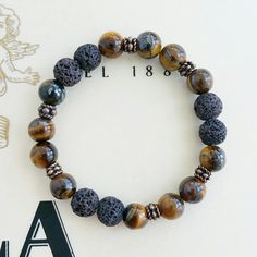 Aromatherapy brown lava and tiger's eye available at www.bellazenbracelets.etsy.com